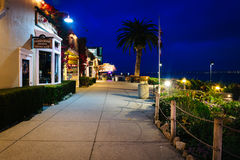 Shops and gardens at Cannery Row at night, in Monterey  Royalty Free Stock Image