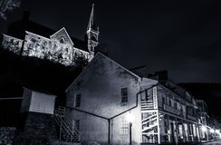 Shops and historic buildings on Shenandoah Street at night in Harper's Ferry, WV Stock Photo