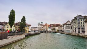Shops and houses along the bank of Reuss River in Lucerne, Switzerland Stock Photo