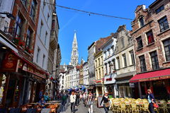 Shops and houses along busy street in Brussels Stock Image