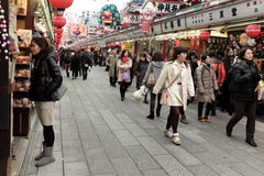 Shops lining the path to Sensoji Temple are filled with New Years holiday shoppers Royalty Free Stock Photo