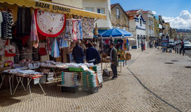 Shops on the main street of Nazare, Portugal. Outdoor shops, market in Nazare, Portugal Stock Photography