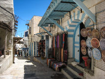 Shops in the medina. Sousse. Tunisia. Typical shops with blue decorated doors in the streets in the medina. Sousse. Tunisia Stock Photography