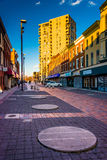 Shops in Old Town Mall and highrise in Baltimore, Maryland. Stock Photo