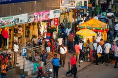Shops, pedestrians and stalls, Kampala, Uganda. Aerial view of Luwum Street late afternoon, with shops, pedestrians and stalls, Kampala, Uganda Royalty Free Stock Photography