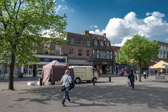Shops and people on St Peters Street in St Albans. St ALBANS, UK - MAY 12, 2016:  Shops on St Peters Street on a sunny Spring day Royalty Free Stock Photo