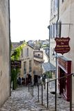 Shops on cobbled medieval steep street in St. Emilion, Aquitaine, Bordeaux, France Royalty Free Stock Photos