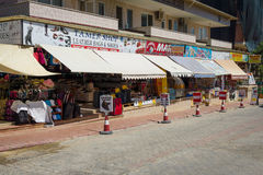 Shops selling clothing, jewelery, knitwear and souvenirs on the Anatolian coast. Royalty Free Stock Image