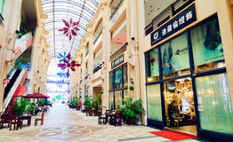 Modern shopping mall center interior,  fashion shops sale display stores window front Stock Images
