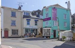 Shops and steps Brixham Torbay Devon Endland UK Stock Photo