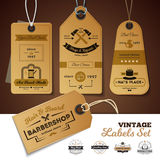 Shops Vintage Labels Set. Set of vintage labels of shops with design of 3d cardboard tags with rope isolated vector illustration Stock Photos