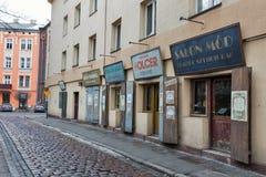 Shops and workshops facade in Kazimierz Jewish district. Krakow, Poland. Shops and workshops on the main street Szeroka of Kazimierz, once the heart of Jewish Stock Photos