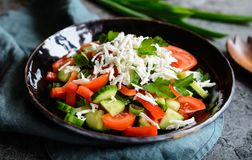 Shopska Salad - Bulgarian salad with tomato, cucumber, pepper, scallion, parsley and cheese Stock Images