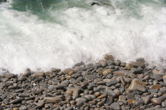 Shore. Image of waves breaking on a rocky beach Royalty Free Stock Photography