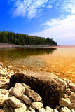 Shore. Beautiful view on a rocky shore with clear water and golden reflections. Georgian Bay, Canada Stock Image