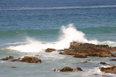 On shore. Wave reaching the shoreline Stock Image