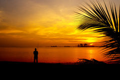 Shore anglers silhouette Stock Images