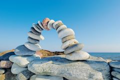 Shore Arc. Curve arc of the pebbles on the sea boulder Royalty Free Stock Photo