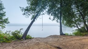 Shore of autumnal foggy lake. Beautiful polish landscape photographed in september at bad weather Royalty Free Stock Images