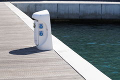 Shore Based Electricity Supply Appliance With Lantern On Top For Boats Power And Battery Charged . Stock Photography