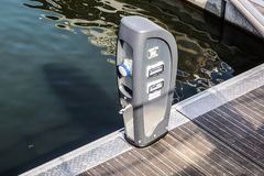 Shore Based Electricity Supply Appliance With Lantern On Top For Boats Power Supply And Battery Charged Royalty Free Stock Photo
