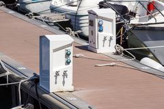 Shore Based Electricity Supply Appliance Power Supply And Battery Charged on the dock stock photo