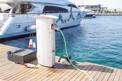 Shore Based Electricity Supply Appliance Power Supply And Battery Charged on the dock . royalty free stock images