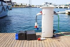 Shore Based Electricity Supply Appliance Power Supply And Battery Charged on the dock . stock images