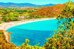 Shore of Beautiful Villasimius Beach at the Bay of the Blue Waters on the Mediterranean Sea on Sardinia Island in Italy in summer. Cagliari region stock image