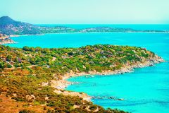 Shore of Beautiful Villasimius Beach and the Bay of the Blue Waters of the Mediterranean Sea on Sardinia Island in Italy in summer. Cagliari region royalty free stock images