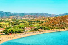 Shore of Beautiful Villasimius Beach at the Bay of the Blue Waters of the Mediterranean Sea on Sardinia Island, Italy in summer. Cagliari region stock photography