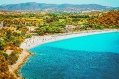 Shore of Beautiful Villasimius Beach at the Bay of the Blue Waters in the Mediterranean Sea in Sardinia Island in Italy in summer. Cagliari region stock photo