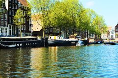 Shore and boats in Amsterdam, Netherlands, Europe royalty free stock photography
