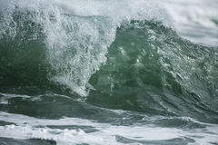 Shore Break. A powerful wave surging and breaking in the shore dump of a beach Stock Image
