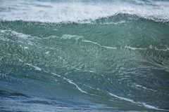 Shore Break. A powerful wave surging and breaking in the shore dump of a beach Royalty Free Stock Photo