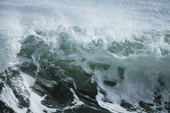 Shore Break. A powerful wave surging and breaking in the shore dump of a beach Royalty Free Stock Image
