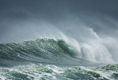 Shore Break. A powerful wave surging and breaking in the shore dump of a beach Stock Photo