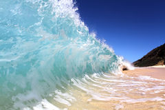 Shore Break. A wave breaks on the shore in Hawaii Royalty Free Stock Photography