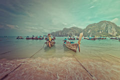 Shore with characteristic boats at Phi Phi Island in Thailand Royalty Free Stock Photos