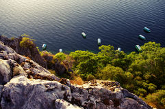 Shore cliff and boats. Boats floating the water to look down from above Stock Photography