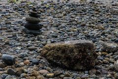 Rocks formed into tower along a shore line Royalty Free Stock Images