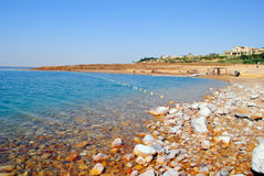 Shore of The Dead Sea. The Dead Sea, also called the Salt Sea, is a salt lake bordering Jordan to the east and Israel and Palestine to the west. Its surface and Royalty Free Stock Photography
