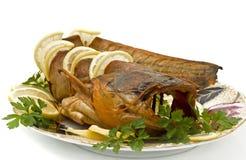 Shore dinner - sheatfish with lemon and parsley Royalty Free Stock Images