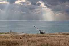 Shore and dramatic clouds over the sea Stock Photography
