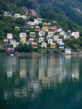 The shore of the fjord and Norwegian city Stock Photo