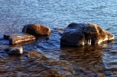 Shore of the freezing river. In Siberia stock photography