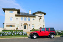 Shore House. Modern house by the ocean  with a red sport wrangler car parking next to it. Deal, NJ Royalty Free Stock Photo