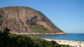 Shore of Itacoatiara hike as seen from Itacoatiara Beach in Niteroi, Brazil.  Royalty Free Stock Photo