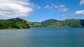 Lagoa Azul lake, Sao Miguel island, Azores, Portugal. Shore of Lagoa Azul lake which is situated in wide volcanic crater called Sete Cidades, filled by tropical stock photography