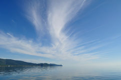 The shore of Lake Baikal and the cloud Royalty Free Stock Photos